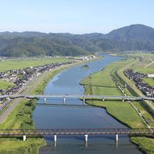 "A landscape of Lower Maruyama River taken from Toyooka Bridge located in the site ""Lower Maruyama River and the surrounding rice paddies"""