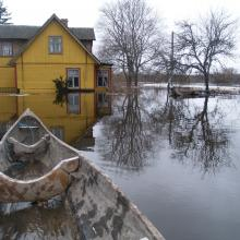 "Dugout canoe is a practical vessel during flood ""fifth"" season."