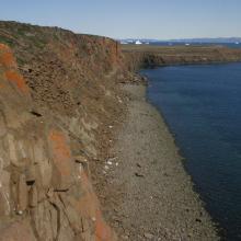 Steep cliff at the island Angissat.